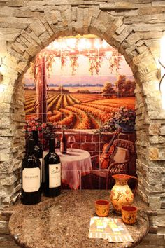 Mediterranean Home Wine Cellar with mural tile.