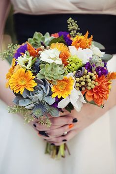 Fall inspired bouquet with a pop of purple and orange.