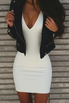 48dfccd045 Sexy white plunging mini dress bodycon with detailed black leather jacket.  Beautiful