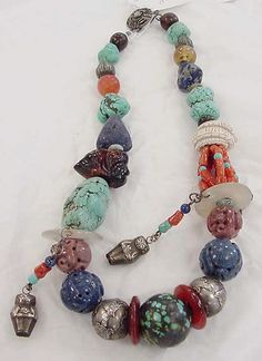 Necklace |  Tibet.  ca. 1875–1925 | Glass, silver, turquoise, stone, coral, cobalt, amber, ivory, cotton
