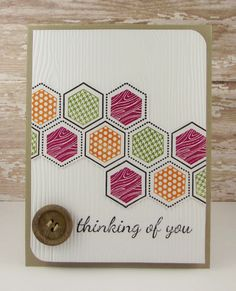 handmade card ... luv the pattern created with stamped hexagon in different patterns and colors ... wood button ,,, white panel with wood grain embossing folder texture ... kraft base card shows as mat edge and where the main panel is rounded on two corners ...