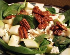 **Spinach salad with apple, feta & caramelised pecans. **Yum! Could have eaten a bowl of the pecans straight from the pan on their own. For the spinach salad added in cherry tomato, cucumber, red onion and I topped mine with feta (boyfriends with blue cheese) Used our own dressing. Served with a chilli glazed salmon on top. Delicious and will definitely be making the pecans again to eat on their own or with salad!