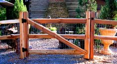 5 ft. walk gate in a 2 hole split rail fence with welded wire attached