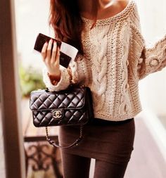 Cream cable knit sweater brown stretch skirt brown tights. Mini channel bag.