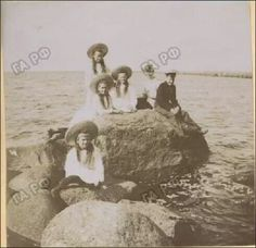 The Grand Duchesses (OTMA) playing on the shore of the Lower Dacha, Peterof, c.1909. In Anna Vyrubova's photo album, they are mentioned as the sons of the Grand Duke Konstantin Konstanovich, Princes Konstantin and Oleg. In other sources, they are just mentioned as cadets. #theromanovs