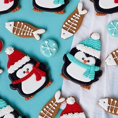 """Simple Penguin Cookies with cute little """"fish-flakes!"""" Oh how I love Christmas Cookies! #sugarcookies #penguincookies #decoratedcookies #decoratedbiscuts #royalicing #ChristmasCookies"""