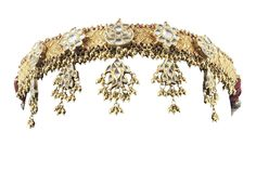 A GOLD AND DIAMOND HEADDRESS INDIA, 19TH CENTURY Formed by a succession of articulated panels, each embossed with confronted birds and central rosette, a row of gold beads hanging from below, with five diamond-set panels to which are attached five beaded diamond-set pendants, on plaited cord core with silver wire, with blue tassel