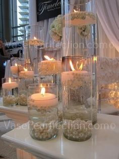 Elegant DIY Pearl and Candle Centerpieces Glass cylinders filled with water and floating candles and pearls. Source by inciferibis The post Elegant DIY Pearl and Candle Centerpieces appeared first on The Most Beautiful Shares. Diy Wedding, Wedding Reception, Rustic Wedding, Wedding Flowers, Wedding Ideas, Trendy Wedding, Summer Wedding, Wedding Tables, Blue Wedding