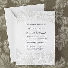 This bright white card is shown with pearlized filigree at the top and bottom.