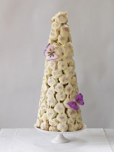 White chocolate croquembouche with butterfly decorations