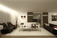 Interior Design, White Fur Rug Black Sofa Flower Vase Wooden Floor Marble Coffee Table Light Brown Potted Plant Glass Candle Holder Galss Sliding Door Cushion Round Table And Living Room Area ~ Splendid Contemporary Interior with Natural Element to Accent