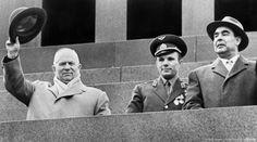 Soviet Cosmonaut Yuri Gagarin (C), Soviet leader Nikita Khrushchev (L) and Leonid Brezhnev (R) salute the crowd on May 01, 1961
