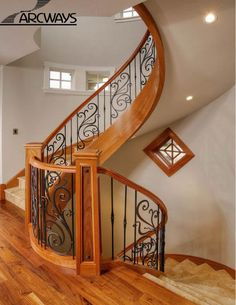 Curved stair case with recessed closed back and marble treads and risers