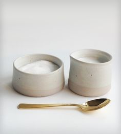 Stockholm Ceramic Cream & Sugar Set by Paper & Clay on Scoutmob Shoppe. White on white on white. Delightful with that gold spoon, too.