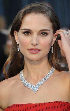 Natalie Portman's Harry Winston necklace, which she wore to the Oscars in 2012. The necklace combined round, pear-shaped, and marquise diamonds. Beautiful V-shape and cluster design of the necklace and how it just sits perfectly on her neck. And to top it off, the actress paired it with Harry Winston diamond drop earrings, which was about 11 carats in total for the pair.