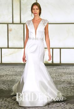 A deep V-neck with short sleeves is unexpected and sexy @rivini | Brides.com