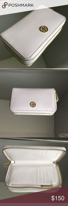 """Tory Burch Robinson Zip Wallet Cream/white colored Saffiano leather with Gold hardware. Wallet is in excellent condition with very Minimal use. Only defects are discoloration on the corner areas from rubbing. Measurements: 7.5""""L x 1""""W x 4.25""""H Tory Burch Accessories"""