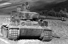 Tiger Abandoned and Captured in Tunisia by American Soldiers.Note the added proctective armor areas indicated by track sections added to the front of the Tiger.