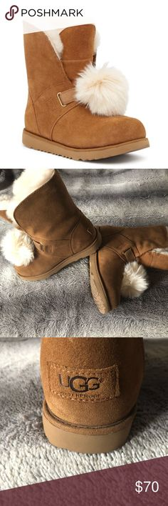 Ugg Isley Pompom Boot (kid size 3) Round toe. Suede construction.  Solid vamp with a removable genuine shearling pompom detail. Pull-on style. Foam cushioned footbed. Lightweight grip sole.  NWT but no box. UGG Shoes Boots