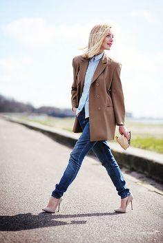 sky blue button-down shirt, oversized camel blazer, skinny jeans, nude pumps, tan clutch