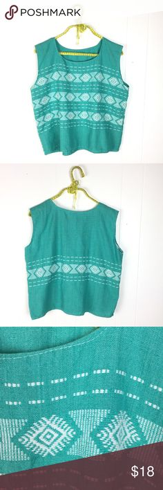 "Vintage Boho Turquoise Embroidered Crop Top Awesome vintage Boho Festival top. Turquoise green with white geometric embroidery. Cropped length. Very good condition. No tags. Feels like cotton. Best for a small or medium. 20 1/2"" shoulder to bottom. 21"" underarm to underarm. Vintage Tops Crop Tops"