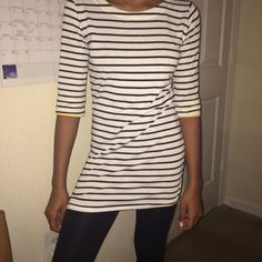 Striped Shirt Black and white striped shirt (sleeves of the shirt can be rolled up to show the yellow) Tops