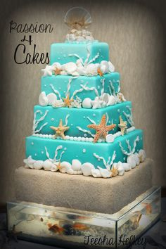 Beach Wedding Cake!  5 Tiered cake on top of a custom made fish tank base filled with live fish! Integrated lights are operated by a wireless remote switch that light up the cake.