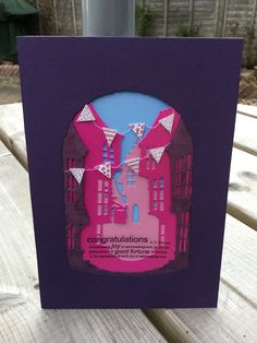 Made with die cut street scene with a congratulations quote - by Caren