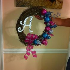 This is my monogramed wreath I made for under $25. I got all if the supply's from hobby lobby with all the Christmas products being 50% off. All that was used was the twig wreath for around $4 and the rest was just being creative with what was was left over. For the letters I got just a plain wooden letter painted it white then used a pencil and dipped the eraser in it and made dots all over the painted letter then sprinkled glitter all over to make the dots.  I used a glue gun to set the…