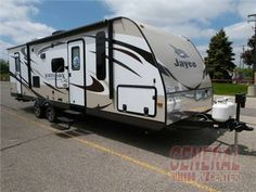 The 2015 28DSBH White Hawk travel trailer by Jayco RV offers a rear bunk house and single slide.  Click To View Additional Photos, Floorplan & Price On This Great Unit From General RV!