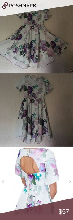 Tea party Awesome floral dress with cut out back, it pleated with grace when put on. Blue or purple shoes will enhance the look by bringing out its patterns! (Uk 6) Dresses