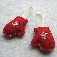 Snowflake stitched felt mittens