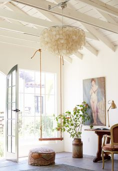 Chandelier made of ivory in lofty white space