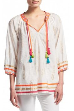 Peasant style top full of bohemian charm with gold foil print and multicolored tassel detail and embroidered trim. Fit loose is intended but the top runs large. Wear with linen pants for a fun summer look or pair with white shorts and gladiator sandals for the weekend. No need for a necklace pair with a statement earring instead.  Shaka Print Top by Calypso St. Barth. Clothing - Tops Pennsylvania