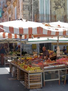 Market in Siracusa, Sicily, Italy remember going here for the freshest produce and fish.