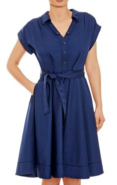 The Blue Caracter Dress exquisite Italian tailoring is sheer class. The ample front placket is perfect for larger busts and shirt dress lovers. Tailored to the waist with a fabric belt that nips the waist, the delightful circle skirt takes on that wonderful fifties Roman Holiday look.
