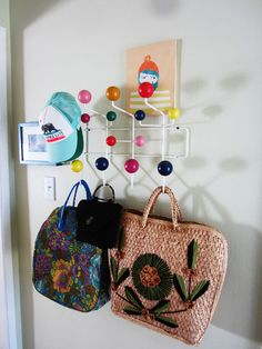 Brighten your entry with colorful hooks. It's the first thing you see as you walk through the door, so why not make it more cheerful? Fun hooks are an easy way to make this area of the home stand out while adding much-needed storage. Try the classic multicolored Eames hooks shown here, whimsical animal-shaped hooks or repurposed vintage glass knobs.