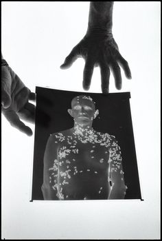 Even before 1979, when Richard Avedon began a project he called In The American West, he had planned to photograph a man covered with bees. He advertised for a subject and found Ronald Fischer, a Chicago banker and amateur beekeeper. In 1981, after queen-bee pheromone was applied to his skin (to attract drones), the tall, shaven headed Fischer stood patiently outdoors in Davis, California, while Avedon exposed one hundred and twenty-one 8 x 10 inch negatives, a
