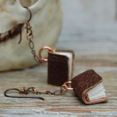 book earrings made from boot leather