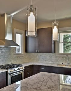 Love the backsplash, counter tops and lights.  Wouldn't mind cooking on that stove, either.