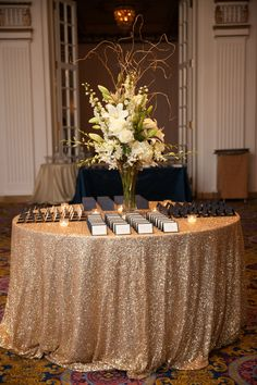 The ornate white and gold interior of Fairmont Copley Plaza in Boston, Massachusetts, played into their theme of timeless elegance. The couple's navy and gold escort cards echoed their invitations.