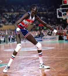 Manute Bol, a Dinka tribesman from the Sudan who was selected by the Washington Bullets overall in the second round of the 1985 NBA draft, defends against the Boston Celtics in a game during his rookie season. (Dick Raphael/NBAE via Getty Images) Manute Bol, Sport Basketball, Love And Basketball, Basketball Legends, Basketball Players, Jordan Basketball, Basketball Court, Giant People, Tall People