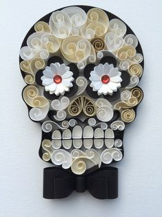 "Mexican Calaveras, the famous ""Sugar Skull"" of the Day of the Dead on quilling to celebrate this beautiful mexican tradition. Origami And Quilling, Quilled Paper Art, Quilling Paper Craft, Paper Crafts, Skull Crafts, Quilling Animals, Quilling Designs, Quilling Ideas, Quilled Creations"