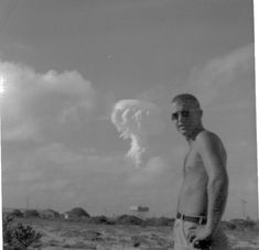 "Caption: ""My grandfather casually looking on as nuclear weapon detonates in the distance."""