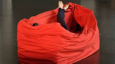 #German designer #HannaEmelieErnsting has developed a #chair with an integrated red blanket that wraps around the sitter like Little Red Ridi...