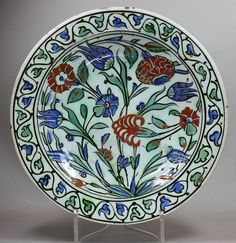 Iznik dish, circa 1600, decorated with blue tulips Ref: V297  Iznik dish, circa 1600, decorated with blue tulips and red flowers, diameter: 27cm., condition: 2 hairlines