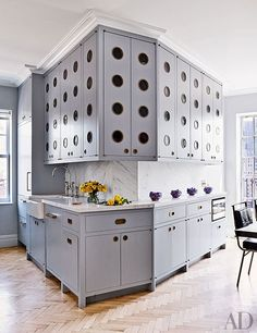 A Greenwich Village Penthouse Designed by Rafael de Cárdenas | The kitchen cabinetry is painted in a Benjamin Moore gray and features bespoke hardware by E. R. Butler & Co.; the sink fittings are by Waterworks.