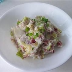 St. Patrick's Colcannon Recipe with red potato, cabbage, butter, butter, minced garlic, green onions, white pepper, milk, corned beef