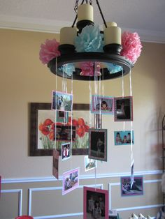 We made a hanging memories mobile for my daughter's graduation open house.  Pictures on both side meant we could use twice as many photos!