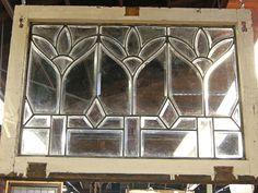 "Leaded beveled glass window; fleur-de-lis  34""w x 25""h  Price: $695.00"